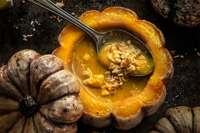 Pumpkin coconut soup with walnut gremolata - delicious, heart-warming pumpkin soup, with crunchy toasted walnuts and garlic gremolata, it's fall comfort food in its best. | www.viktoriastable.com