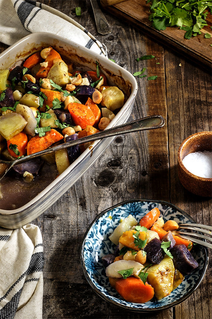 Roasted root vegetables. Cooked in coconut milk, and topped with salty, crunchy macademia nuts, these are so sweet, creamy and delicious that you will get addicted! You may even skip the pie - they are so good! | www.viktoriastable.com