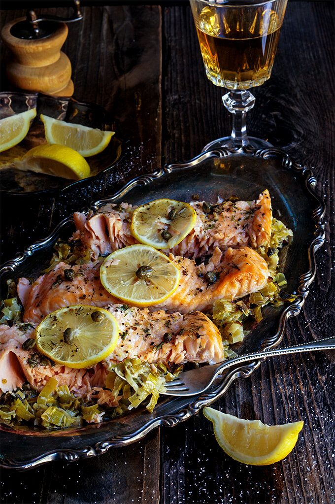Baked salmon with creamy leeks is a classic and all time favorite recipe - simple, yet absolutely delicious, it's perfect for entertaining, and quick to make! | www.viktoriastable.com
