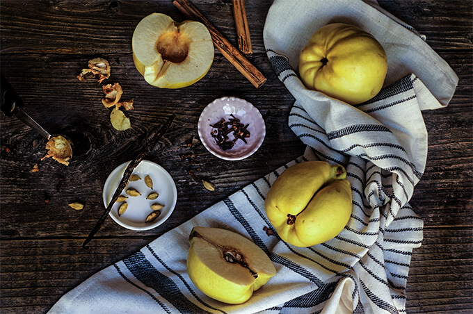 Slow-roasted quinces with ricotta and pistachios. With their intoxicating floral aroma, and soft, melt-in-your-mouth sweet flesh, these slow-roasted quinces, topped with honey ricotta, and pistachios are sure to become your favorite fall dessert recipe! | www.viktoriastable.com