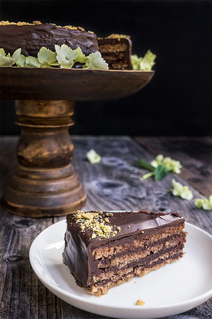 Garash cake - layers of walnut meringue and rich dark chocolate cream, enveloped in silky chocolate ganache - the ultimate chocolate lover's cake, perfect for that special occasion! | www.viktoriastable.com