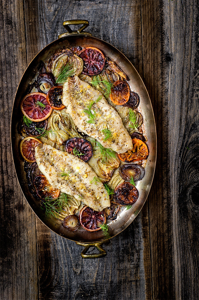 Baked rockfish with fennel and blood oranges - caramelized fennel, roasted blood oranges and juicy white fish fillets - you get a burst of citrusy, fresh flavors, and a vibrant, delicious dinner that's sure to impress, and is quick and easy to make. | www.viktoriastable.com