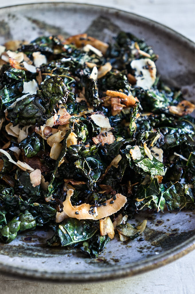 Kale salad with toasted coconut and sesame oil - this fantastic salad has it all - it's crunchy, it's salty, it's satisfying, and feels like comfort food, yet is a health bomb. | www.viktoriastable.com