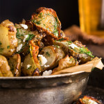 Roasted Jerusalem artichokes - sprinkled with feta cheese and drizzled with garlic dill butter - they are simply finger-licking good! | www.viktoriastable.com