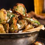 Roasted Jerusalem artichokes {feta + garlic dill butter}