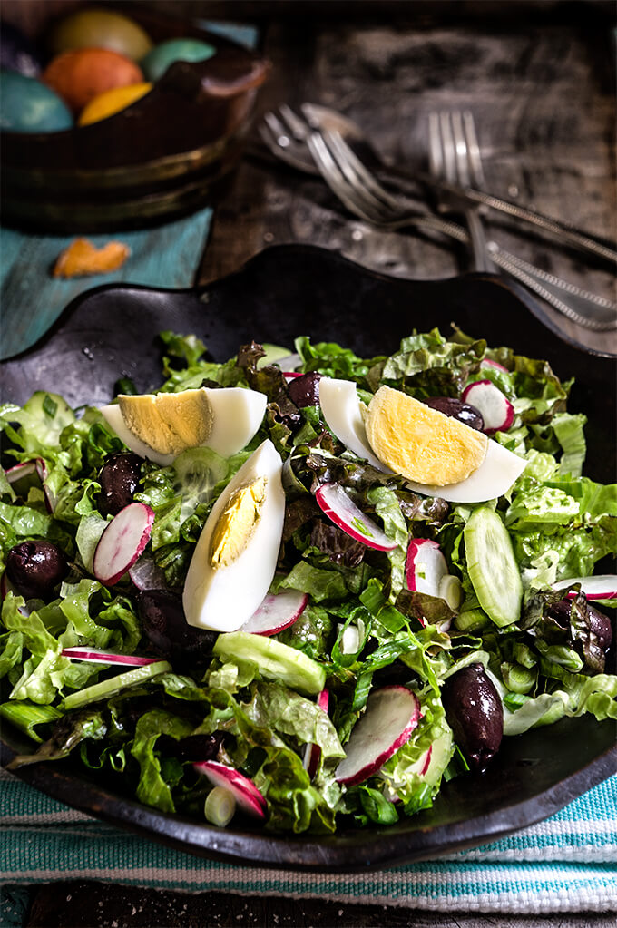 Easter salad - tender lettuce, cucumbers, radishes, green garlic, kalamata olives, boiled eggs - this salad is a celebration of spring at every bite, and a great use of left over Easter eggs. | www.viktoriastable.com