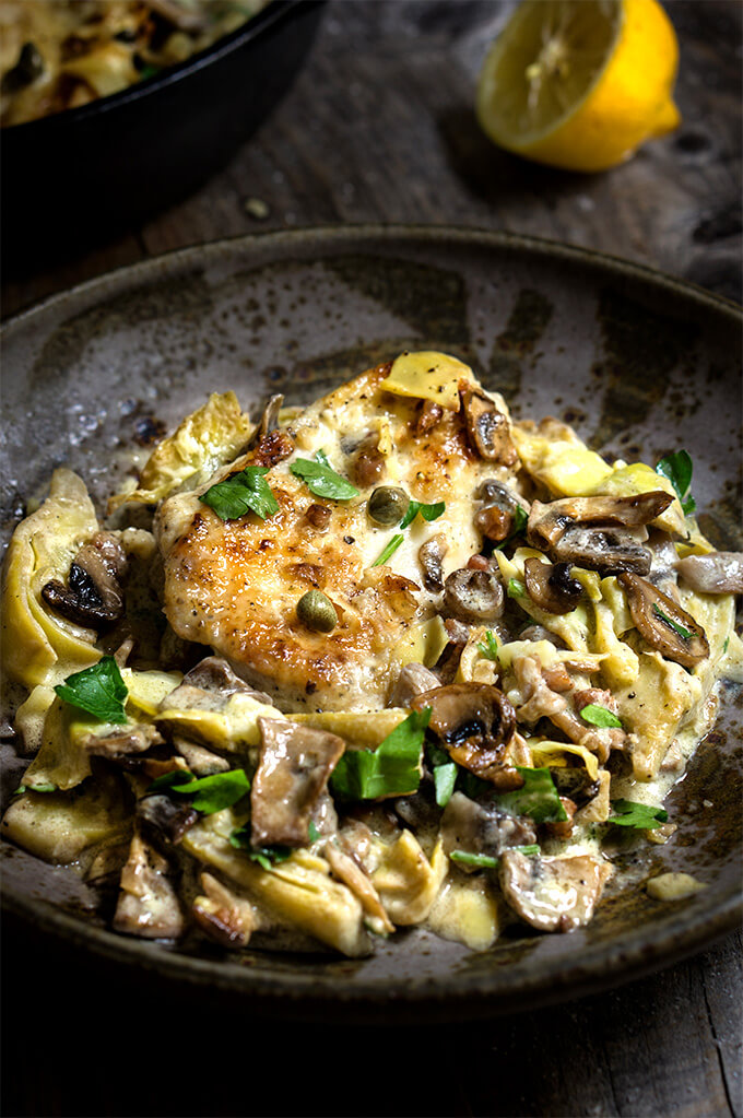 Chicken scallopini with mushrooms and artichokes in a luscious lemon butter sauce - simply divine! | www.viktoriastable.com