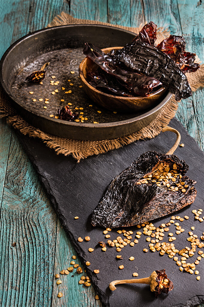 Chocolate hazelnut chicken mole - hints of dark chocolate and toasted nuts, touch of sweetness, and layer upon layer of complex flavors that blend into this sublime mole sauce, spooned over cooked chicken. | www.viktoriastable.com
