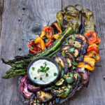 Marinated grilled vegetables with whipped goat cheese - eggplants, peppers, zucchini, asparagus, and onions, marinated and grilled till soft on the inside and charred on the outside, then doused in garlicky marinade, and served with whipped goat cheese on the side. | www.viktoriastable.com