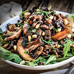 Sauteed oyster and brown mushrooms, black lentils, and caramelized onions are the basis for this lovely fall salad, with pine nuts and capers adding a great flavor boost.
