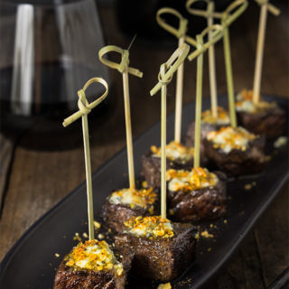 Steak bites with blue cheese butter and smoked pepita crumb - seared to perfection, bursting with flavor, tender steak bites are smeared with melting bluecheese butter, and a crunchy topping of smoked pepitas!   www.viktoriastable.com