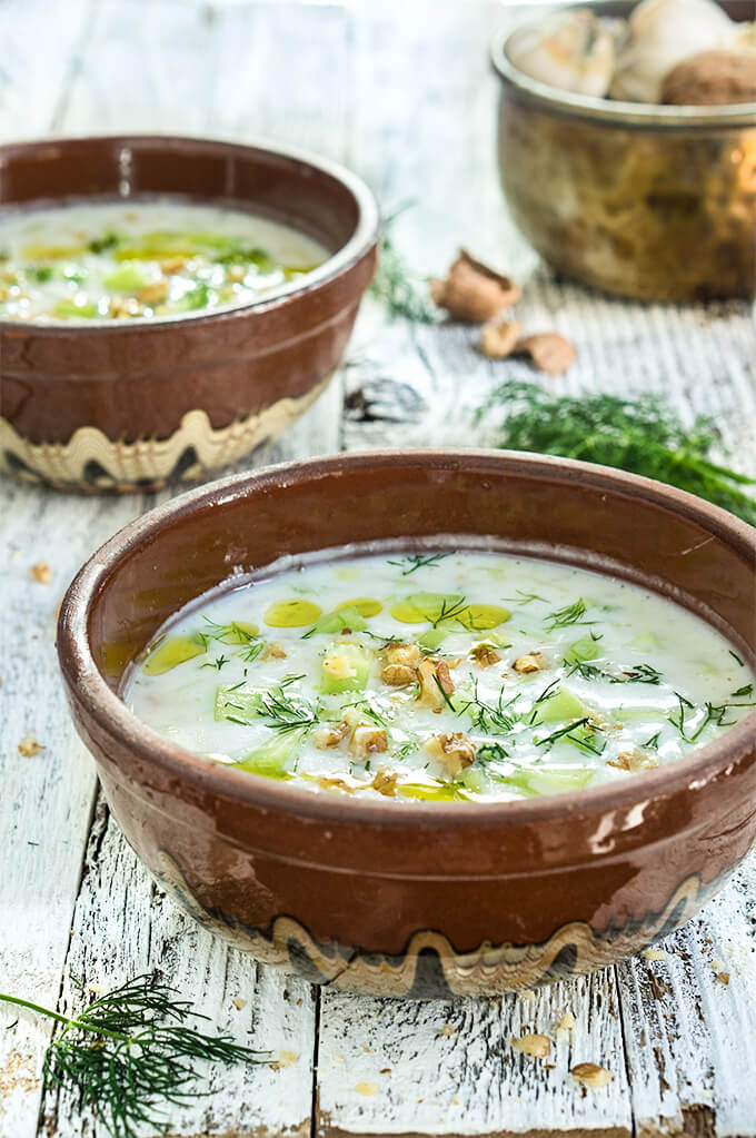 Cold cucumber yogurt soup - garlic, walnuts, dill, fresh cucumbers and chilled yogurt make this soup super delicious and quite refreshing on a hot day. | www.viktoriastable.com