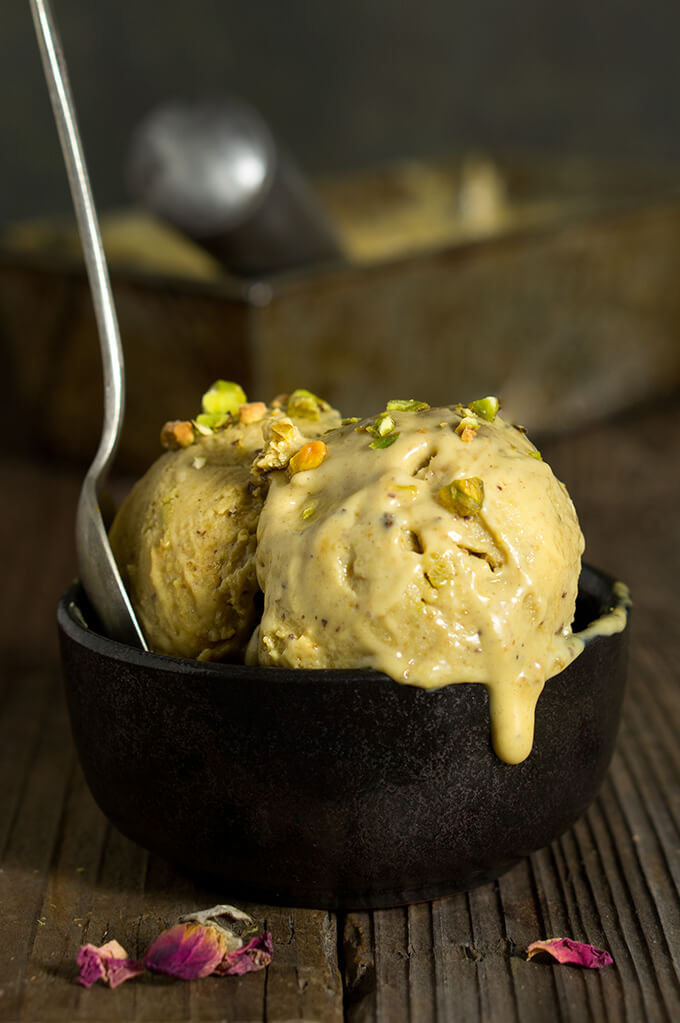 Pistachio rose ice cream - rich, creamy and outrageously delicious, spiked with rose water and cardamom, it's the strongest pistachio flavored ice cream I've tasted, and you can easily make it at home! | www.viktoriastable.com