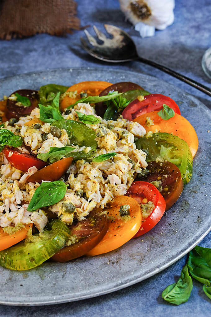 Garlic tuna tomato salad - loaded with aromatic basil and garlic, tangy capers and sharp mustard flavors, this is a super delicious summer salad that works great for a light dinner. | www.viktoriastable.com