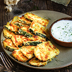 Oven-fried zucchini crisps with garlic yogurt dip - this is a fantastic summer finger food, quick and easy to make, and so delicious you need to triple the recipe! | www.viktoriastable.com