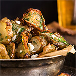 Roasted Jerusalem artichokes - sprinkled with feta cheese and drizzled with garlic dill butter - they are simply finger-licking good!