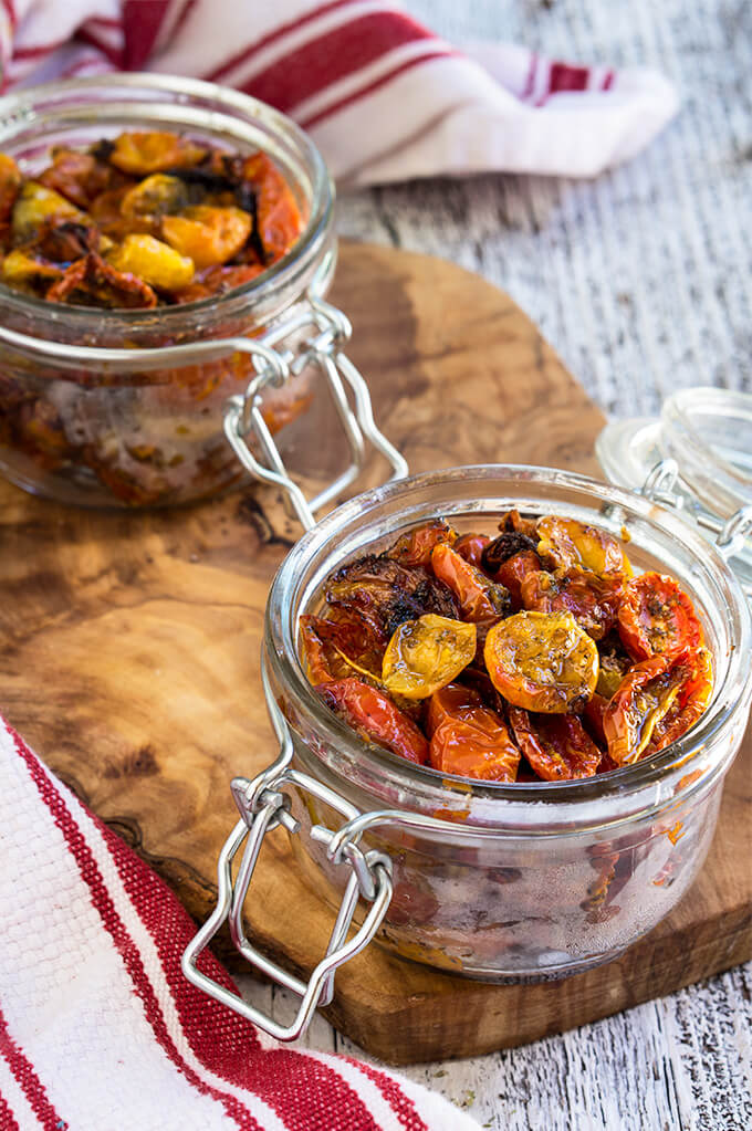 Slow roasted tomatoes - packed with garlic and herb flavors, slightly caramelized and chewy, these tomatoes are so flavorful and versatile, you will want to put them on anything. | www.viktoriastable.com