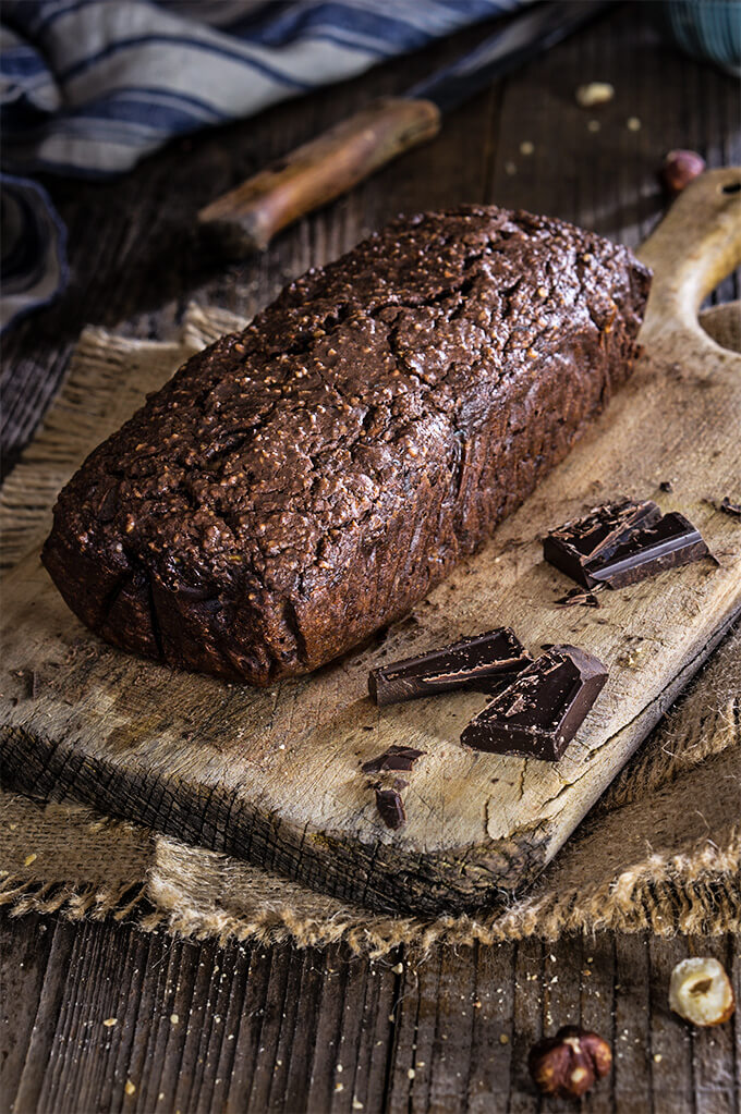 Chocolate hazelnut zucchini bread - sinfully delicious, super moist, and rich, with intense dark chocolate hazelnut flavor, this bread is the ultimate chocolate lover indulgence, yet it's healthy too - low in sugar, gluten free, and full of good fats, and fiber. | www.viktoriastable.com