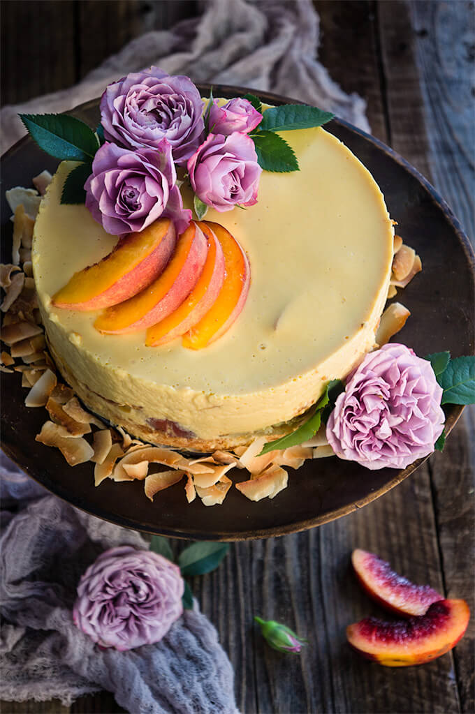 Coconut macaroon peach panna cotta cake - made with coconut cream, tangy yogurt, and fresh peaches, this cake is light and fruity, creamy and luxurious - a real summer treat. | www.viktoriastable.com