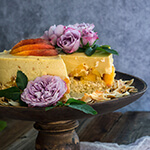 Coconut macaroon peach panna cotta cake - made with coconut cream tangy yogurt, and fresh peaches, this cake is light and fruity, creamy and luxurious - a real summer treat. | www.viktoriastable.com