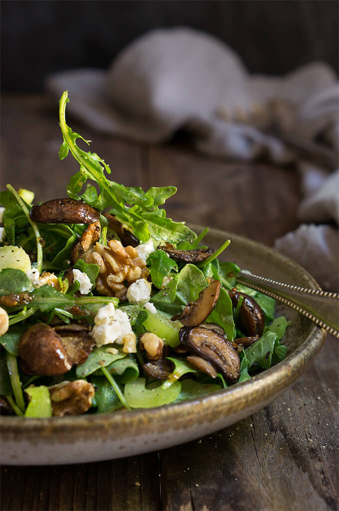 Mushroom and arugula salad with goat cheese, toasted walnuts, and celery - tossed