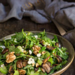 Mushroom and arugula salad with goat cheese, toasted walnuts, and celery - tossed in shallot mustard and truffle oil vinaigrette, this salad is bursting with earthy, fall flavors. | www.viktoriastable.com