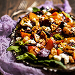Roasted beets salad with caramelized garlic, toasted walnuts and goat cheese - the ultimate fall salad with vibrant colors and comfort food feel.| www.viktoriastable.com
