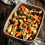 Roasted root vegetable cooked in coconut milk, and topped with salty, crunchy macademia nuts. | www.viktoriastable.com