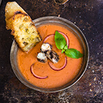 Salmorejo - Spanish creamy tomato and bread soup, served chilled, and topped with smoked sardines, and chopped red onion.| www.viktoriastable.com