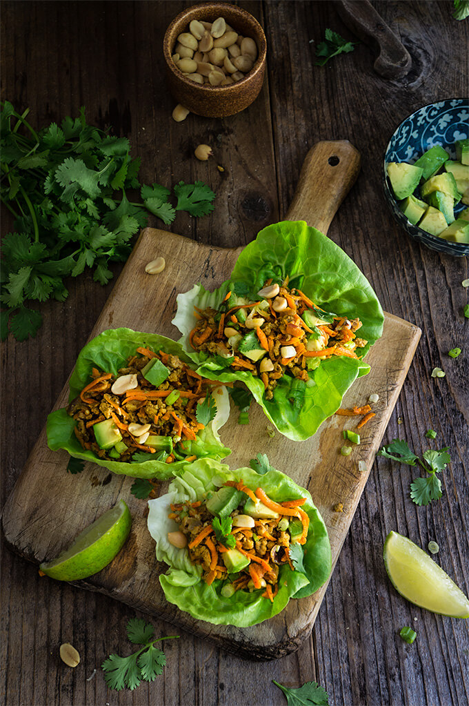 Spiced ground turkey lettuce wraps - a quick and healthy weeknight meal, one of our top favorites, these wraps are loaded with veggies, and warm spices, and topped with crunchy peanuts, fresh cilantro and creamy avocado. | www.viktoriastable.com