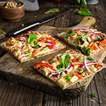 Thai chicken pizza - loaded with toppings, and bursting with bright flavors. | www.viktoriastable.com