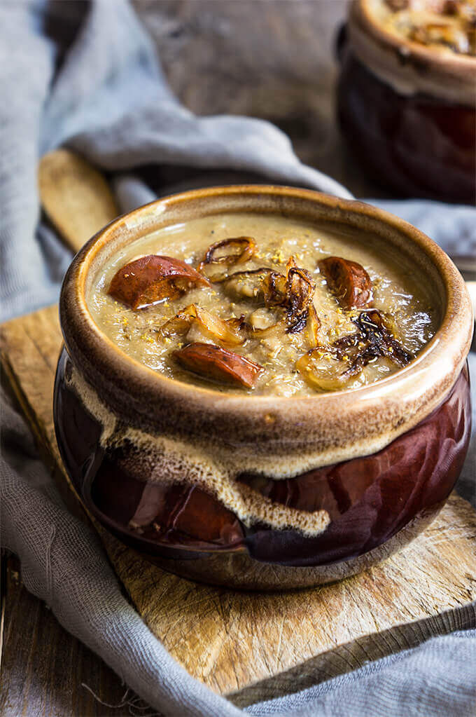 Caramelized onion, lentils and mushroom soup - creamy, hearty and decadent soup, topped with smoked sausage and fennel pollen for an irresistible depth of flavors. | www.viktoriastable.com