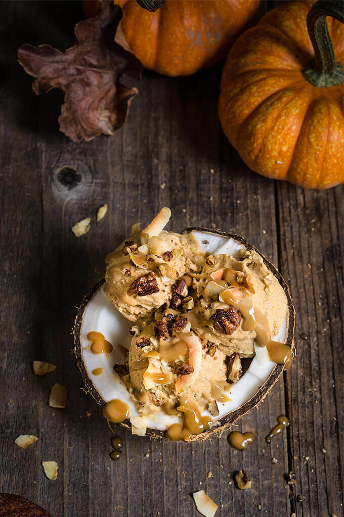 Pumpkin ice cream with coconut caramel and praline pecans - 3 ingredients, no-churn, vegan ice cream that's as creamy and delicious as pumpkin pie, and totally decadent, drizzled with coconut caramel, toasted coconut chips, and maple-spiced praline pecans. | www.viktoriastable.com