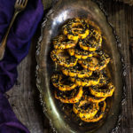 Sesame-roasted, maple chipotle delicata squash - crunchy sesame crust, sweet and spicy soft interior, fun looking, and so freakishly delicious, it's scary - these are your perfect Halloween treat! | www.viktoriastable.com