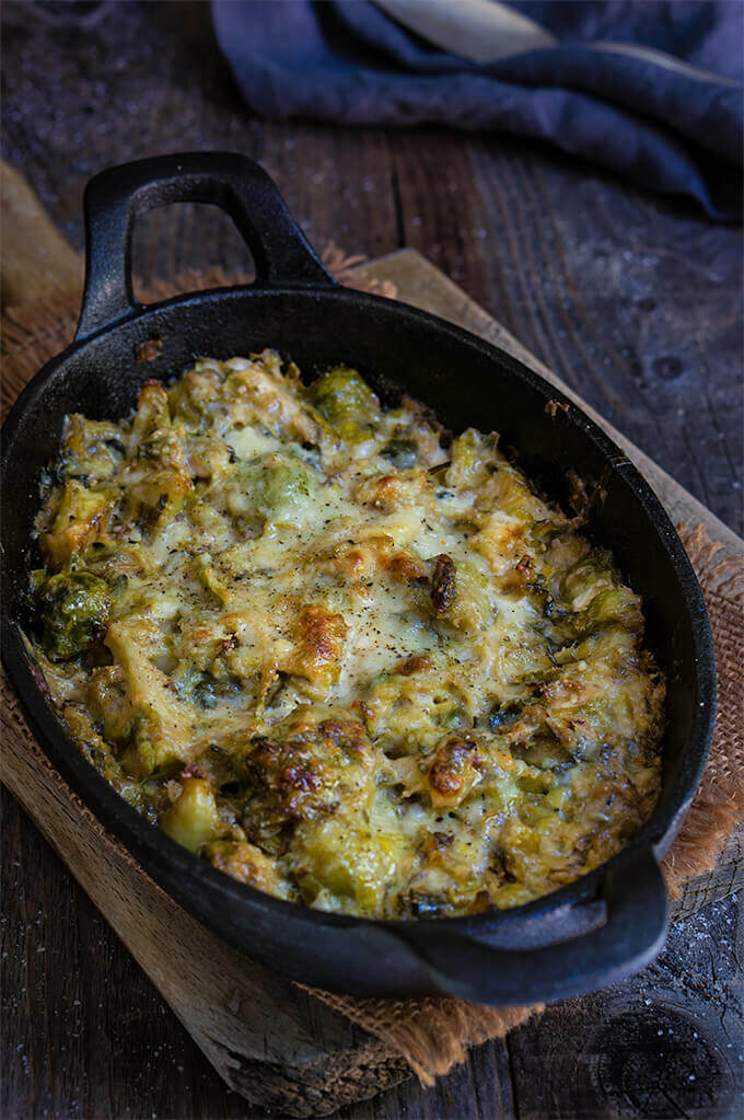 Creamy brussles sprouts and leeks - creamy, cheesy, and bursting with flavors of sweet caramelized leeks, garlic and cumin - this recipe is quick, easy and utterly delicious.| www.viktoriastable.com