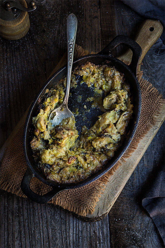Creamy brussles sprouts and leeks - creamy, cheesy, and bursting with flavors of sweet caramelized leeks, garlic and cumin - this recipe is quick, easy and utterly delicious.  www.viktoriastable.com