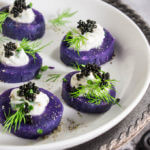 Purple potato bites with horseradish creme fraiche and caviar