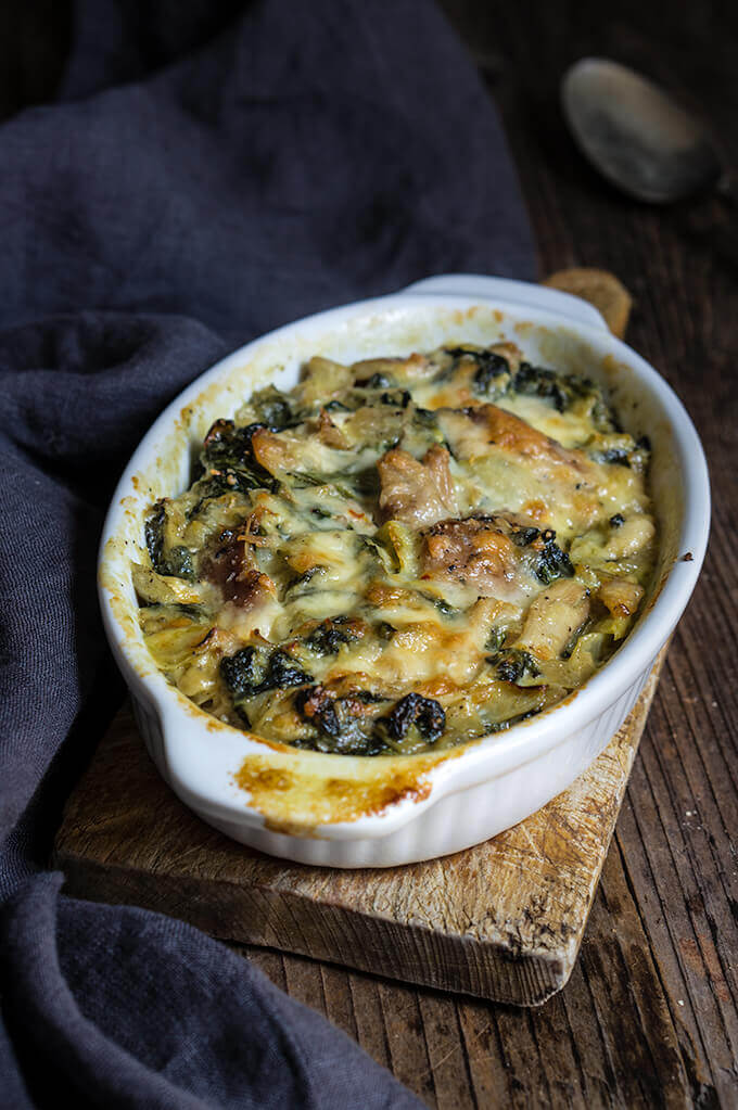 Spinach artichoke chicken casserole - this quick and easy recipe tastes like a cross between spinach artichoke dip, and chicken bake, takes 30 minutes to make, and is a great way to use leftover chicken or Thanksgiving turkey meat. | www.viktoriastable.com