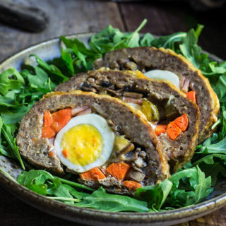 Stuffed meatloaf - flavorful juicy meat, stuffed with mushrooms, ham, smoked cheese, boiled eggs, carrots and pickles - this is one fancy meal, perfect for a special occasion, or holiday.| www.viktoriastable.com