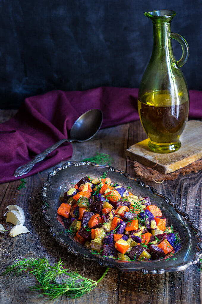 Beet and carrot salad with mustard garlic vinaigrette - boiled root veggies, crunchy pickles and lots of fresh dill drizzled with a lovely mustard garlick dressing - a fantastic winter salad that's easy on the calories, yet filling and satisfying. | www.viktoriastable.com