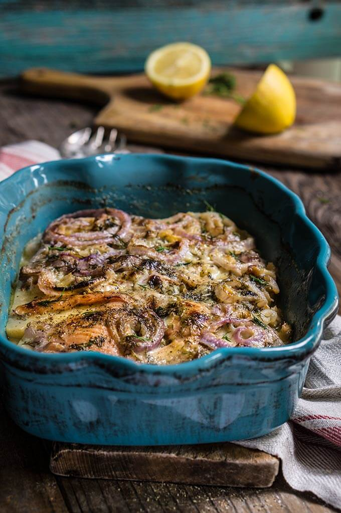Celery root and smoked salmon gratin - in this creamy dish, aromatic celery root pairs beautifully with smoked fish, red onions and dill-flavored creme fraiche for a quick and easy dinner. | www.viktoriastable.com