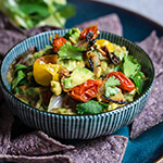 Roasted vegetable guacamole - this slight twist on the beloved avocado dip is bursting with lovely charred flavors of sweet caramelized onions, tomatoes and jalapeños, smoky cumin, and bright citrus and floral notes from the lime and cilantro. | www.viktoriastable.com