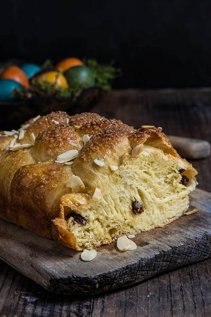Bulgarian Easter bread - kozunak is a cotton-soft, sugar-crusted sweet bread, studded with rum-soaked raisins, and perfumed with vanilla and lemon zest - the ultimate Easter treat. | www.viktoriastable.com