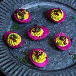 Beet-pickled curry deviled eggs - pickled in beet marinade for a gorgeous magenta color, then stuffed with a delicious curry filling, they make a spectacular appetizer, and a great way to utilize those leftover Easter eggs. | www.viktoriastable.com