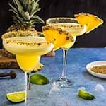 Spicy pineapple margarita - icy-cold, with a spicy kick, fruity and refreshing, served with a fragrant rim of chili lime salt, this drink will give you just the right amount of heat and freshness. | www.viktoriastable.com