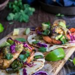 Grilled shrimp tacos with tomatillo salsa and homemade tortillas - bursting with flavor, juicy shrimp, grilled poblano peppers and tomatoes, topped with freshly made salsa verde, and served over soft homemade flour tortillas. | www.viktoriastable.com