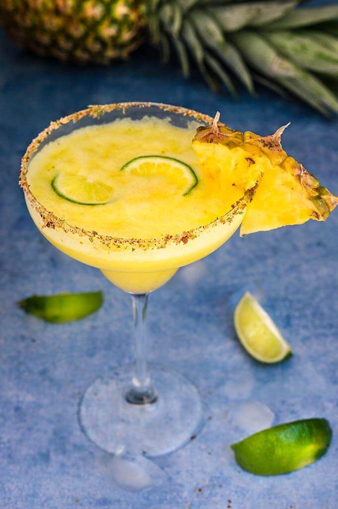 Spicy pineapple margarita - icy-cold, with a spicy kick, fruity and refreshing, served with fragrant chili lime salt, this drink will give you just the right amount of heat and freshness. | www.viktoriastable.com
