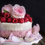 White chocolate coconut raspberry mousse cake - light, delicate, and festive, this no-bake cake is super indulgent, with layers of raspberry mascarpone cheese, and white chocolate coconut mousse on top. | www.viktoriastable.com