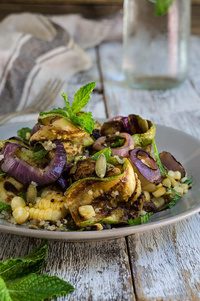 Grilled zucchini and corn quinoa salad - loaded with sweet, grilled summer veggies, healthy quinoa and crunchy toasted pepitas, and bursting with fresh, citrus and mint flavors - so bright, delicious and filling. | www.viktoriastable.com