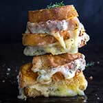 Garlic and herb loaded grilled cheese sandwich - four different cheeses, flavored with garlic and thyme, come into play, to create the ultimate, grilled cheese lover's dream sandwich. | www.viktoriastable.com